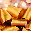 Gold gift bow with festive lights Poster by Elena Elisseeva