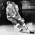 Gordie Howe skating with the puck Print by Sanely Great