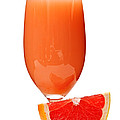 Grapefruit juice in glass Poster by Elena Elisseeva