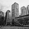 green space in front of high rise apartment condo blocks in the west end between robson and west geo Print by Joe Fox