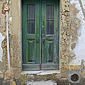 Green Wood Door with Hand Carved Stone in the Medieval Village Of Obidos Print by David Letts