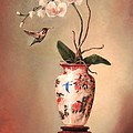 Hummingbird and White Orchid Print by Lori  McNee