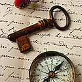 Key ring and compass Print by Garry Gay