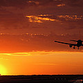 Landing into the Sunset Print by Andrew Soundarajan