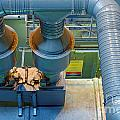Large industrial interior with power generator Poster by Oliver Sved