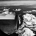 looking out of aircraft window over engine and snow covered fjords and coastline of norway europe Print by Joe Fox