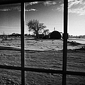 looking out through door window to snow covered scene in small rural village of Forget Saskatchewan  Poster by Joe Fox