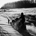 man on snowmobile crossing frozen fields in rural Forget canada Print by Joe Fox