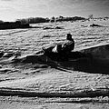 man on snowmobile crossing frozen fields in rural Forget Saskatchewan Canada Print by Joe Fox