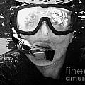 man snorkeling with mask and snorkel in clear water dry tortugas florida keys usa Print by Joe Fox