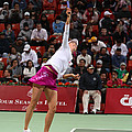 Maria Sharapova serves in Doha Poster by Paul Cowan