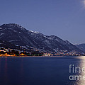Moonlight over a lake Print by Mats Silvan