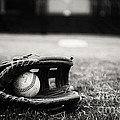 Old Baseball and Glove on Field Poster by Danny Hooks