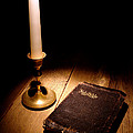 Old Bible and Candle Print by Olivier Le Queinec
