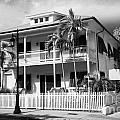 old historic wooden two storey building with white picket fence key west florida usa Poster by Joe Fox