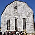 Old Tractor in front of Hay Barn Print by Bill Cannon