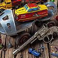 Older roller skate and toys Print by Garry Gay
