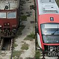 One new and one old train Print by Deyan Georgiev