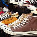 Outdoor Vendor Sells Canvas Shoes Print by Yali Shi