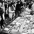 people buying chocolates on display inside the la boqueria market in Barcelona Catalonia Spain Print by Joe Fox
