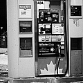 petro canada winter gas fuel pump at service station Regina Saskatchewan Canada Print by Joe Fox