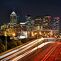 Philadelphia Skyline at Night in Color car light trails Print by Jon Holiday