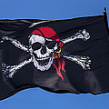 Pirate skull flag with red scarf Print by Garry Gay