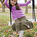 Portrait Of Young Girl On Swing Print by Vast Photography