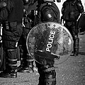 PSNI officer in full riot gear with shield on crumlin road at ardoyne shops belfast 12th July Poster by Joe Fox