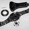 replacing the battery in a metal band wristwatch Print by Joe Fox