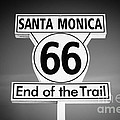 Route 66 Sign in Santa Monica in Black and White Poster by Paul Velgos