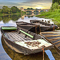 Rowboats on the French Canals Print by Debra and Dave Vanderlaan