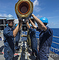 Sailors Load Rim-7 Sea Sparrow Missiles Poster by Stocktrek Images