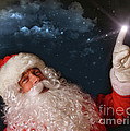 Santa pointing with magical light to the sky Print by Sandra Cunningham
