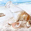 Seashells in a bottle on the beach Print by Sandra Cunningham