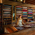 Sewing - Minding the mending store Print by Mike Savad