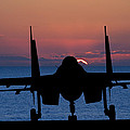 Silhouette of military attack aircraft against vibrant sunset sk Poster by Matthew Gibson