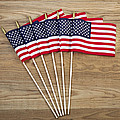 Small American Flags on Aged Wood  Poster by Tom  Baker