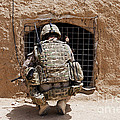 Soldier Searches A Compound Print by Stocktrek Images