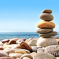 Stack of pebble stones on white Print by Sandra Cunningham