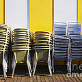 Stacks of Chairs and Tables Print by Carlos Caetano
