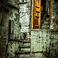 Stairs leading to the old door Print by Catherine Arnas