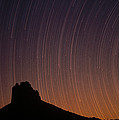 Startrails Over Shiprock In The Four Poster by Tim Fitzharris