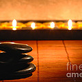 Stone Cairn and Candles for Quiet Meditation Print by Olivier Le Queinec