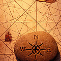 Stone compass on old map Print by Garry Gay
