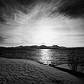 sun setting with halo over snow covered telegrafbukta beach Tromso troms Norway europe Print by Joe Fox