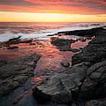 Sunset over rocky coastline Print by Johan Swanepoel