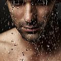 Thoughtful man face under pouring water Print by Oleksiy Maksymenko