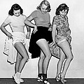 Three Women Lift Their Skirts Print by Underwood Archives