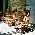 Three Wooden Rocking Chairs on Sunny Porch Poster by Susan Savad
